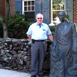 Fred Hawthorne with the statue of President Dwight D. Eisenhower
