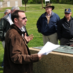 Garry Adelman speaking with a group at Fort Stevens