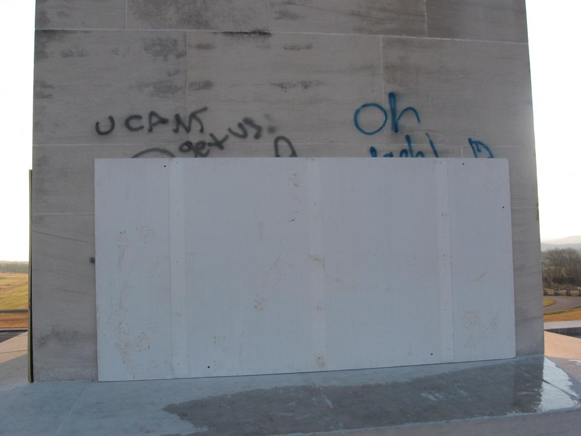 Close-up of partially covered vandalism