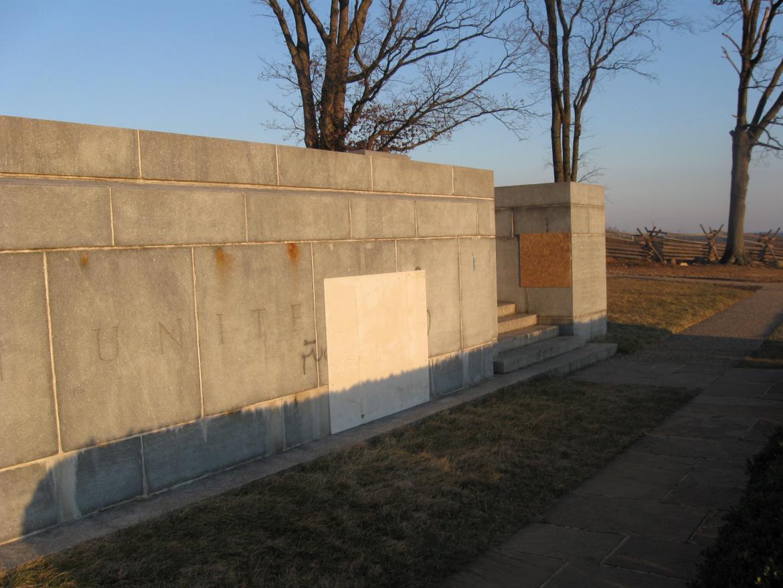Base of Peace Light with graffiti