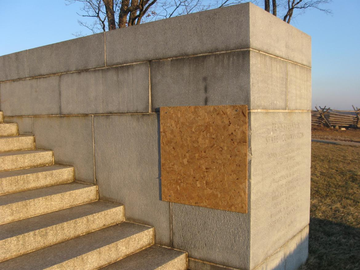 Vandalism covered by plywood